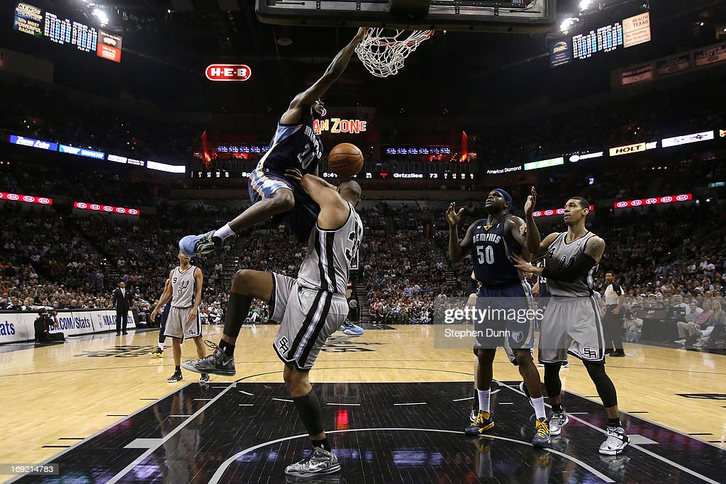 <a gi-track='captionPersonalityLinkClicked' href=/galleries/search?phrase=Quincy+Pondexter&family=editorial&specificpeople=4176540 ng-click='$event.stopPropagation()'>Quincy Pondexter</a> #20 of the Memphis Grizzlies dunks over <a gi-track='captionPersonalityLinkClicked' href=/galleries/search?phrase=Boris+Diaw&family=editorial&specificpeople=201505 ng-click='$event.stopPropagation()'>Boris Diaw</a> #33 of the San Antonio Spurs in the fourth quarter during Game Two of the Western Conference Finals of the 2013 NBA Playoffs at AT&T Center on May 21, 2013 in San Antonio, Texas.