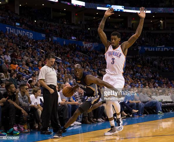 Quincy Pondexter of the Memphis Grizzlies handles the ball against Perry Jones of the Oklahoma City Thunder at the Chesapeak Energy Arena on October...