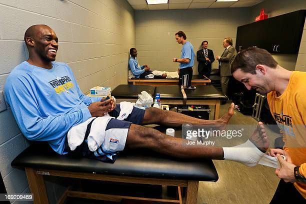 Quincy Pondexter of the Memphis Grizzlies laughs as he gets taped up by a trainer in the locker room before playing the San Antonio Spurs in Game Two...