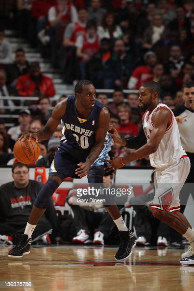 Quincy Pondexter of the Memphis Grizzlies posts up against CJ Watson of the Chicago Bulls during the NBA game on January 1 2012 at the United Center...