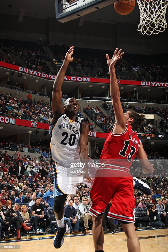 <a gi-track='captionPersonalityLinkClicked' href=/galleries/search?phrase=Quincy+Pondexter&family=editorial&specificpeople=4176540 ng-click='$event.stopPropagation()'>Quincy Pondexter</a> #20 of the Memphis Grizzlies puts up a shot over <a gi-track='captionPersonalityLinkClicked' href=/galleries/search?phrase=Joakim+Noah&family=editorial&specificpeople=699038 ng-click='$event.stopPropagation()'>Joakim Noah</a> #13 of the Chicago Bulls on December 17, 2012 at FedExForum in Memphis, Tennessee.
