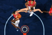 Quincy Pondexter of the Memphis Grizzlies rebounds against Carlos Delfino of the Houston Rockets on March 29 2013 at FedExForum in Memphis Tennessee...