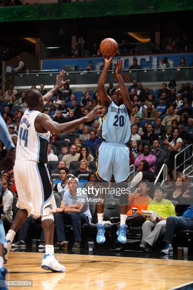 Quincy Pondexter of the Memphis Grizzlies shoots against Andrew Nicholson of the Orlando Magic on March 3 2013 at Amway Center in Orlando Florida...