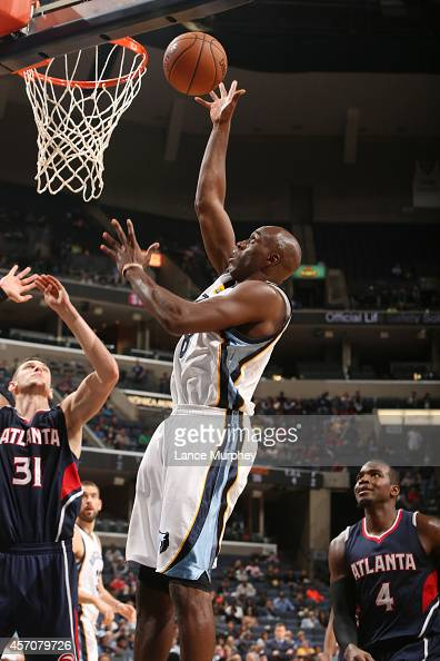 Quincy Pondexter of the Memphis Grizzlies shoots against the Atlanta Hawks on October 11 2014 at FedExForum in Memphis Tennessee NOTE TO USER User...