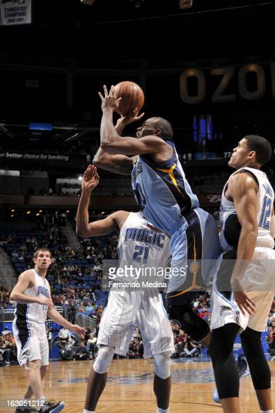 Quincy Pondexter of the Memphis Grizzlies shoots against Tobias Harris of the Orlando Magic on March 3 2013 at Amway Center in Orlando Florida NOTE...