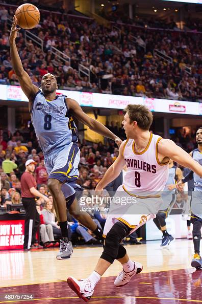 Quincy Pondexter of the Memphis Grizzlies shoots over Matthew Dellavedova of the Cleveland Cavaliers during the first half at Quicken Loans Arena on...