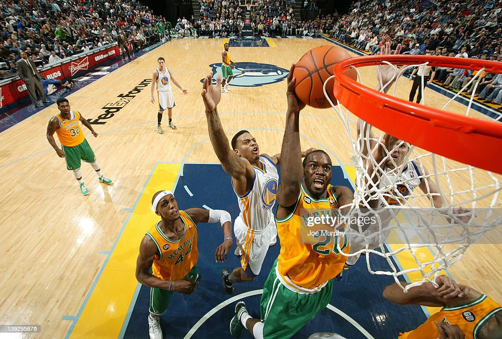 Quincy Pondexter #20 of the Memphis Grizzlies takes the ball to the basket <a gi-track='captionPersonalityLinkClicked' href=/galleries/search?phrase=Brandon+Rush+-+Basketball+Player&family=editorial&specificpeople=802089 ng-click='$event.stopPropagation()'>Brandon Rush</a> #20 of the the Golden State Warriors on February 18, 2012 at FedExForum in Memphis, Tennessee.