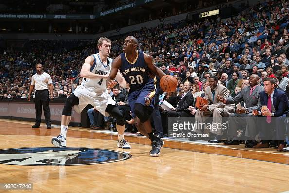Quincy Pondexter of the New Orleans Pelicans drives to the basket against Robbie Hummel of the Minnesota Timberwolves on January 23 2015 at Target...