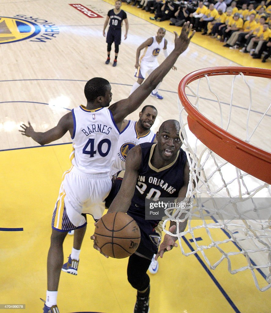 Quincy Pondexter of the New Orleans Pelicans goes in for a layup over Harrison Barnes of the Golden State Warriors in the first half during the first...