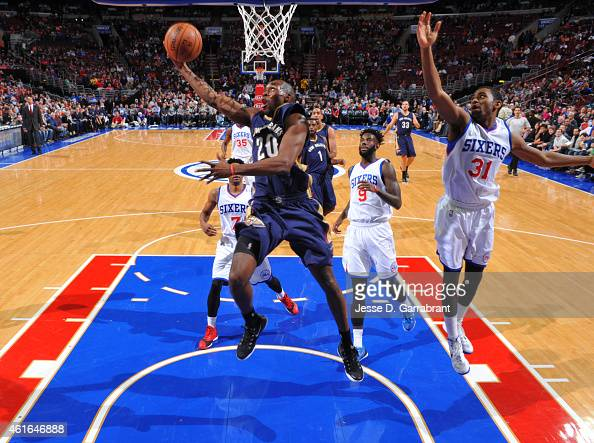 Quincy Pondexter of the New Orleans Pelicans goes up for the layup against the Philadelphia 76ers at Wells Fargo Center on January 16 2015 in...