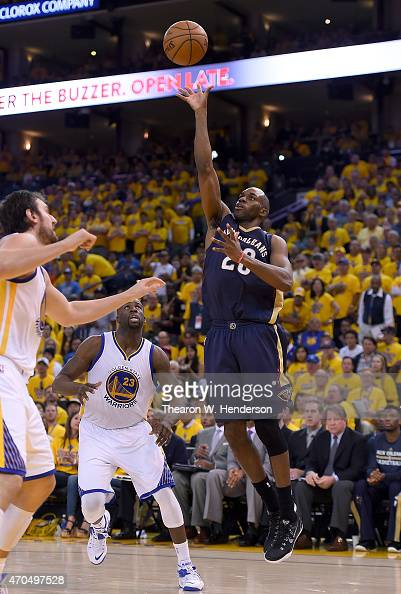 Quincy Pondexter of the New Orleans Pelicans shoots over Andrew Bogut of the Golden State Warriors in the third quarter during the first round of the...