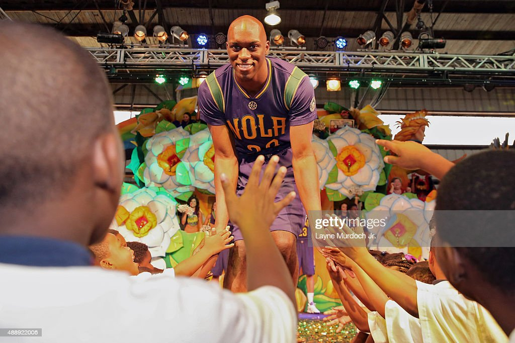 Quincy Pondexter of the New Orleans Pelicans unveils the Mardi Grasthemed Pride uniforms to be worn during the 201516 season on September 17 2015 at...