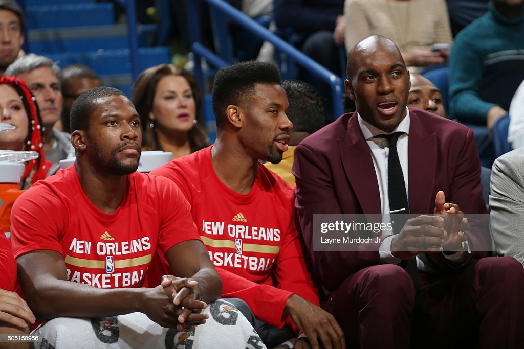 Quincy Pondexter speaks with Norris Cole of the New Orleans Pelicans on the bench during the game against the Charlotte Hornets on January 15 2016 at...