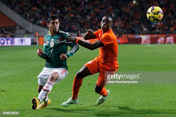 Quincy Promes of Netherlands and Jesus Corona Ruiz of Mexico battle for the ball during the international friendly match between Netherlands and...