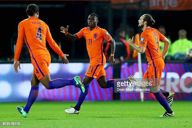 Quincy Promes of the Netherlands celebrates scoring his teams first goal of the game during the FIFA 2018 World Cup Qualifier between Netherlands and...