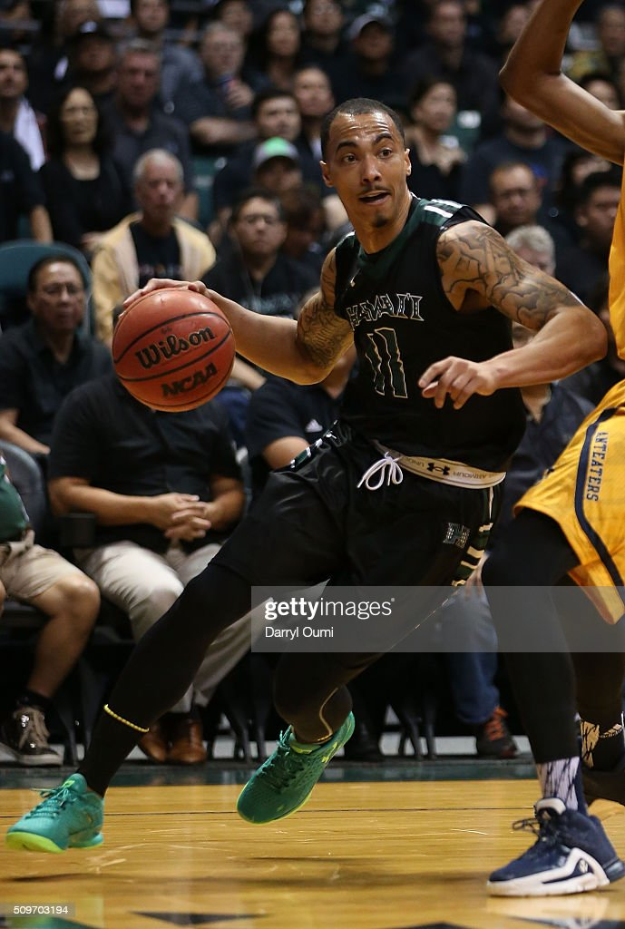 Quincy Smith #11 of the Hawai'I Rainbow Warriors drives the baseline against the UC Irvine Anteaters at Stan Sheriff Center on February 12, 2016 in Honolulu, Hawaii.
