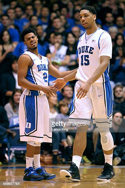 Quinn Cook and Jahlil Okafor of the Duke Blue Devils react against the Furman Paladins during their game at Cameron Indoor Stadium on November 26...