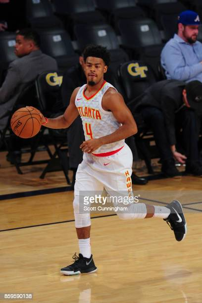 Quinn Cook of the Atlanta Hawks handles the ball during the 201718 NBA preseason game against the Memphis Grizzlies on October 9 2017 at McCamish...