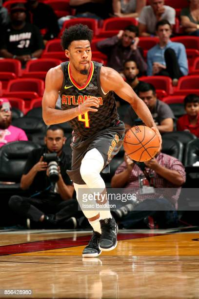 Quinn Cook of the Atlanta Hawks handles the ball during the preseason game against the Miami Heat on October 1 2017 at American Airlines Arena in...