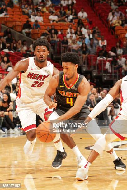 Quinn Cook of the Atlanta Hawks handles the ball during the preseason game against Justise Winslow of the Miami Heat on October 1 2017 at American...