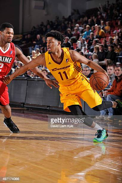 Quinn Cook of the Canton Charge drives to the hoop against Corey Walton of the Maine Red Claws at the Canton Memorial Civic Center on November 14...