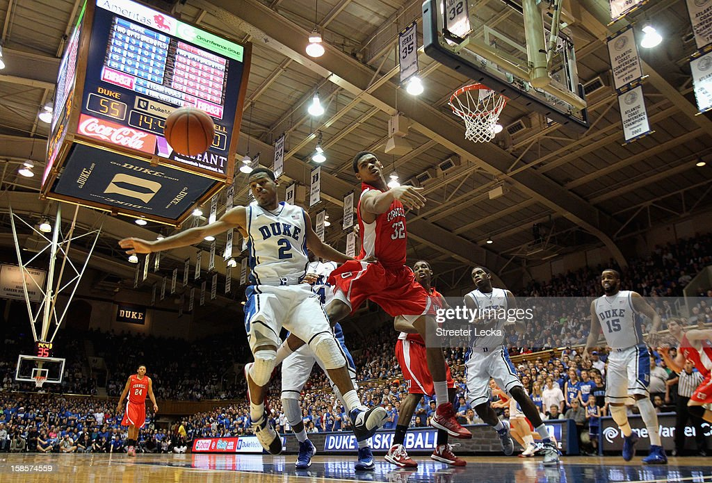 <a gi-track='captionPersonalityLinkClicked' href=/galleries/search?phrase=Quinn+Cook&family=editorial&specificpeople=6753591 ng-click='$event.stopPropagation()'>Quinn Cook</a> #2 of the Duke Blue Devils and Shonn Miller #32 of the Cornell Big Red go after a loose ball during their game at Cameron Indoor Stadium on December 19, 2012 in Durham, North Carolina.