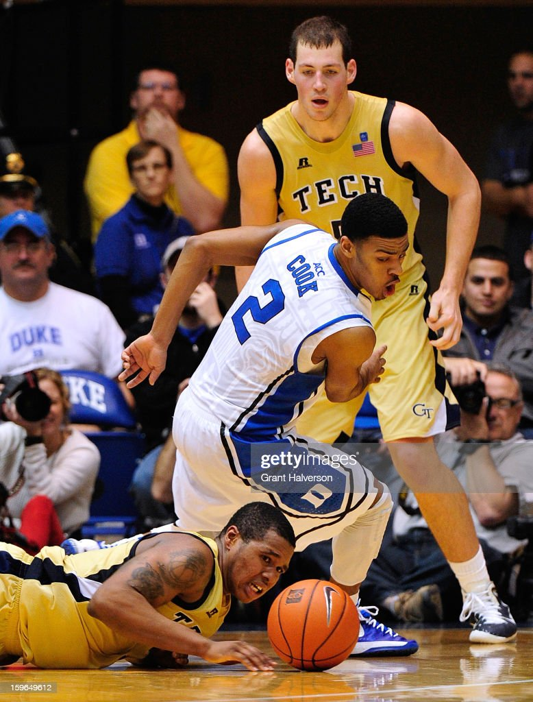 Quinn Cook #2 of the Duke Blue Devils battles for a loose ball with Marcus Georges-Hunt #3 and Daniel Miller #5 of the Georgia Tech Yellow Jackets during play at Cameron Indoor Stadium on January 17, 2013 in Durham, North Carolina. Duke won 73-57.