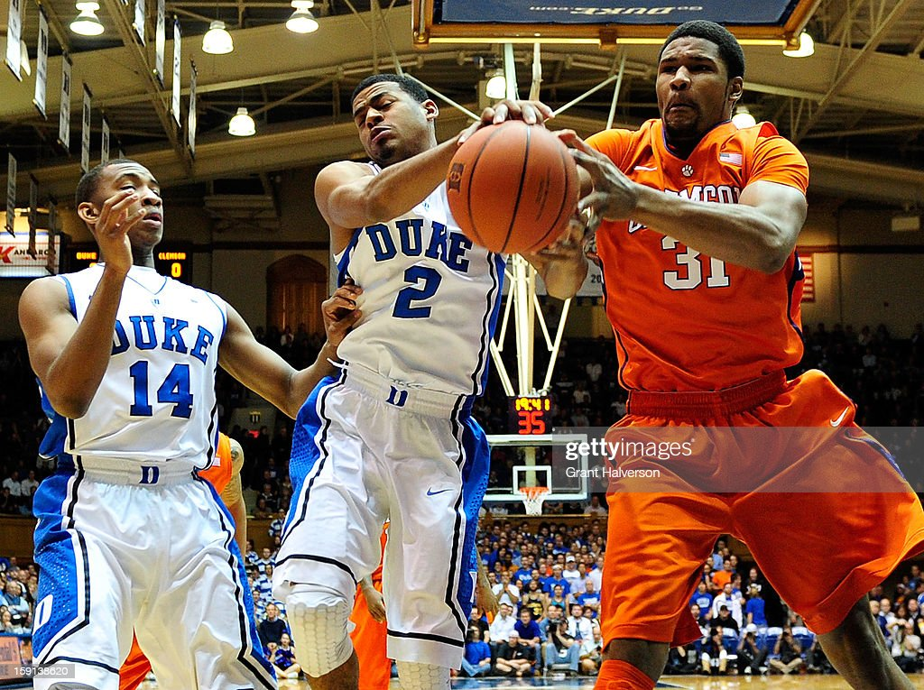 <a gi-track='captionPersonalityLinkClicked' href=/galleries/search?phrase=Quinn+Cook&family=editorial&specificpeople=6753591 ng-click='$event.stopPropagation()'>Quinn Cook</a> #2 of the Duke Blue Devils battles for a rebound against Devin Booker #31 of the Clemson Tigers during play at Cameron Indoor Stadium on January 8, 2013 in Durham, North Carolina.