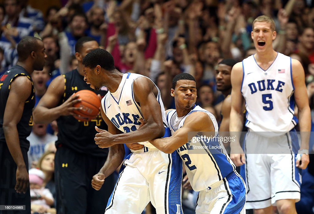 <a gi-track='captionPersonalityLinkClicked' href=/galleries/search?phrase=Quinn+Cook&family=editorial&specificpeople=6753591 ng-click='$event.stopPropagation()'>Quinn Cook</a> #2 of the Duke Blue Devils celebrates with teammate Amile Jefferson #21 after a basket as <a gi-track='captionPersonalityLinkClicked' href=/galleries/search?phrase=Mason+Plumlee&family=editorial&specificpeople=5792012 ng-click='$event.stopPropagation()'>Mason Plumlee</a> #5 watches on during their game against the Maryland Terrapins at Cameron Indoor Stadium on January 26, 2013 in Durham, North Carolina.