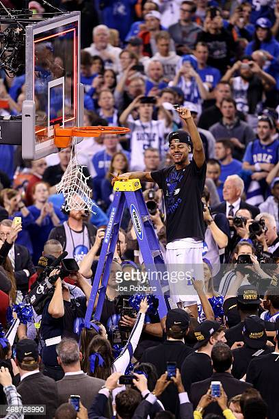 Quinn Cook of the Duke Blue Devils cuts down the net after defeating the Wisconsin Badgers during the NCAA Men's Final Four National Championship at...