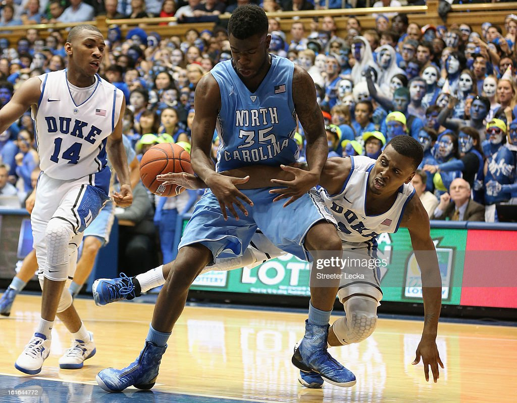 Quinn Cook #2 of the Duke Blue Devils dives after the ball with Reggie Bullock #35 of the North Carolina Tar Heels during their game at Cameron Indoor Stadium on February 13, 2013 in Durham, North Carolina.