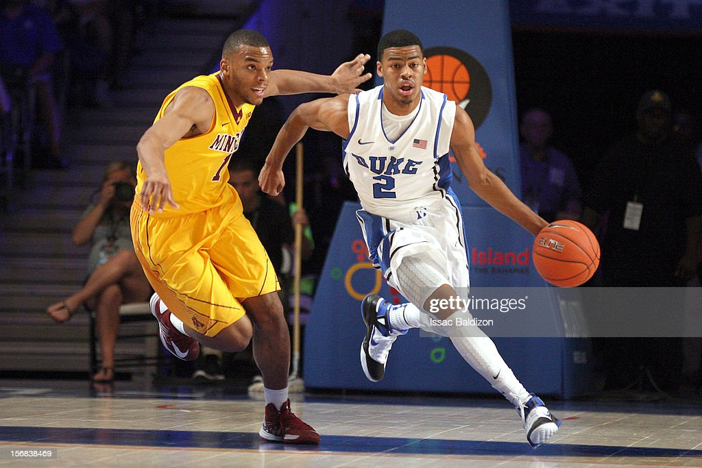 Quinn Cook #2 of the Duke Blue Devils dribbles up court against Maurice Walker #15 of the Minnesota Gophers during the Battle 4 Atlantis tournament at Atlantis Resort on November 22, 2012 in Nassau, Paradise Island, Bahamas.