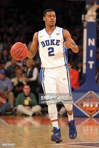 Quinn Cook of the Duke Blue Devils dribbles up court against the Alabama Crimson Tide during their semifinal game of the NIT Season TipOff at Madison...