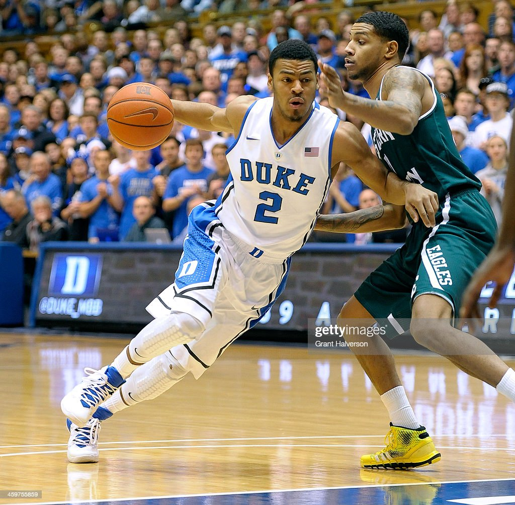 <a gi-track='captionPersonalityLinkClicked' href=/galleries/search?phrase=Quinn+Cook&family=editorial&specificpeople=6753591 ng-click='$event.stopPropagation()'>Quinn Cook</a> #2 of the Duke Blue Devils drives against Raven Lee #0 of the Eastern Michigan Eagles during their game at Cameron Indoor Stadium on December 28, 2013 in Durham, North Carolina. Duke won 82-59.