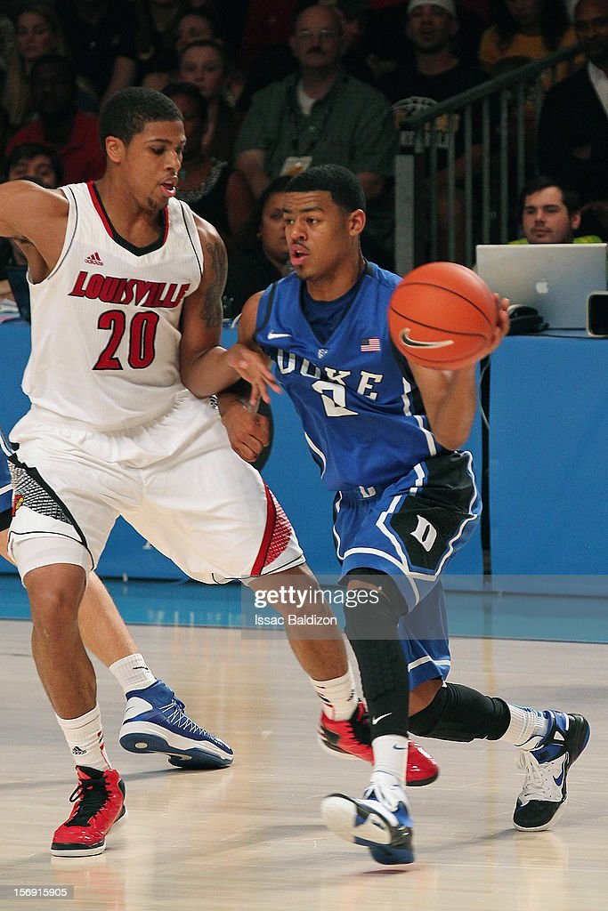 Quinn Cook #2 of the Duke Blue Devils drives against Wayne Blackshear #20 of the Louisville Cardinals during the Battle 4 Atlantis tournament at Atlantis Resort November 24, 2012 in Nassau, Paradise Island, Bahamas.