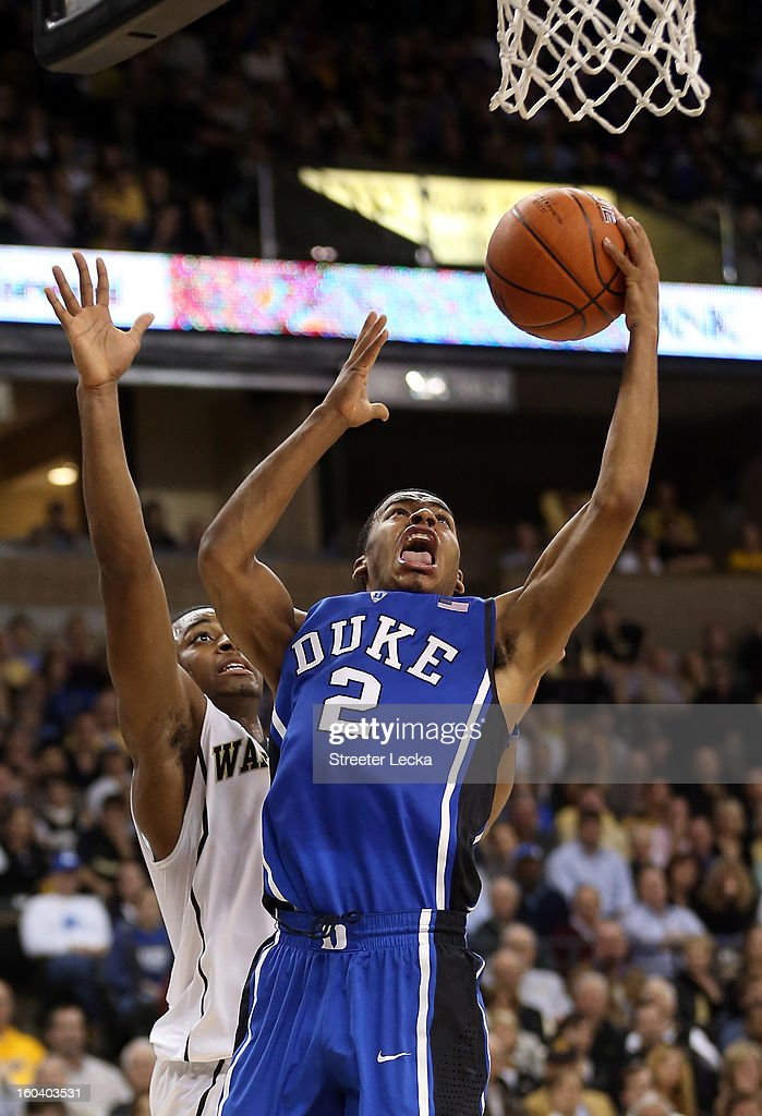 Quinn Cook #2 of the Duke Blue Devils drives past Madison Jones #1 of the Wake Forest Demon Deacons during their game at Lawrence Joel Coliseum on January 30, 2013 in Winston-Salem, North Carolina.