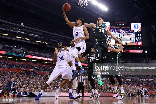 Quinn Cook of the Duke Blue Devils drives to the basket against Gavin Schilling of the Michigan State Spartans in the second half during the NCAA...