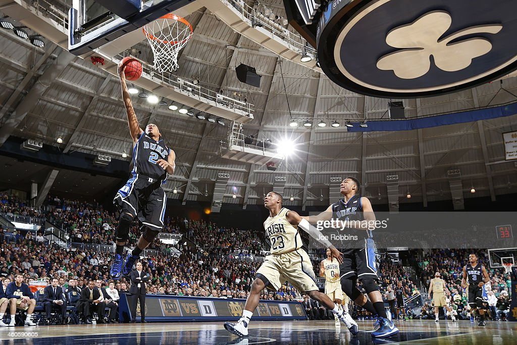 <a gi-track='captionPersonalityLinkClicked' href=/galleries/search?phrase=Quinn+Cook&family=editorial&specificpeople=6753591 ng-click='$event.stopPropagation()'>Quinn Cook</a> #2 of the Duke Blue Devils drives to the basket against the Notre Dame Fighting Irish during the first half of the game at Purcell Pavilion at the Joyce Center on January 4, 2014 in South Bend, Indiana.