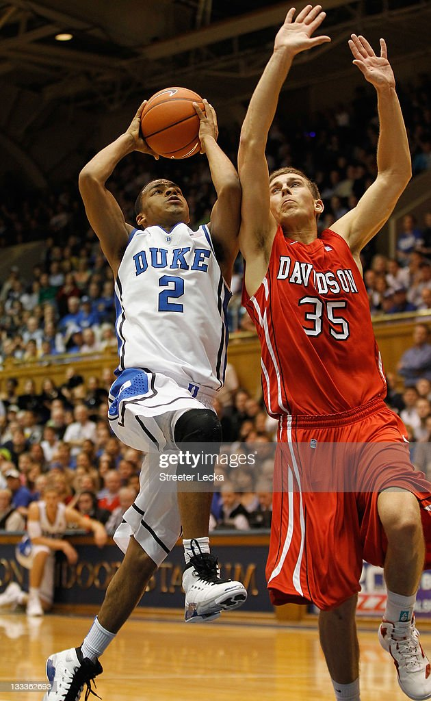 Quinn Cook #2 of the Duke Blue Devils drives to the basket on Chris Czerapowicz #35 of the Davidson Wildcats during their game at Cameron Indoor Stadium on November 18, 2011 in Durham, North Carolina.