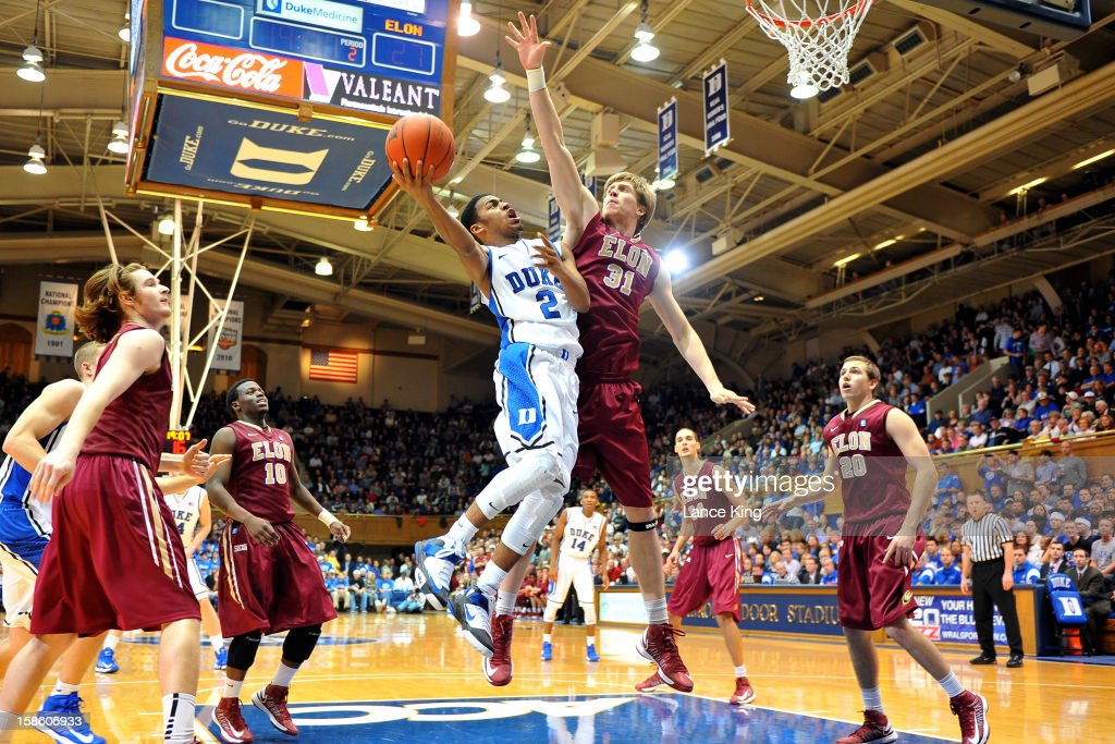 <a gi-track='captionPersonalityLinkClicked' href=/galleries/search?phrase=Quinn+Cook&family=editorial&specificpeople=6753591 ng-click='$event.stopPropagation()'>Quinn Cook</a> #2 of the Duke Blue Devils goes to the hoop against Lucas Troutman #31 of the Elon Phoenix at Cameron Indoor Stadium on December 20, 2012 in Durham, North Carolina. Duke defeated Elon 76-54.