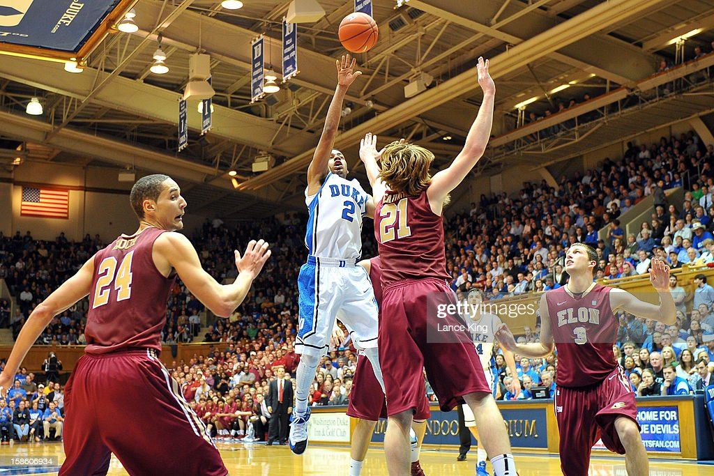 <a gi-track='captionPersonalityLinkClicked' href=/galleries/search?phrase=Quinn+Cook&family=editorial&specificpeople=6753591 ng-click='$event.stopPropagation()'>Quinn Cook</a> #2 of the Duke Blue Devils puts up a shot against Ryley Beaumont #21 of the Elon Phoenix at Cameron Indoor Stadium on December 20, 2012 in Durham, North Carolina. Duke defeated Elon 76-54.