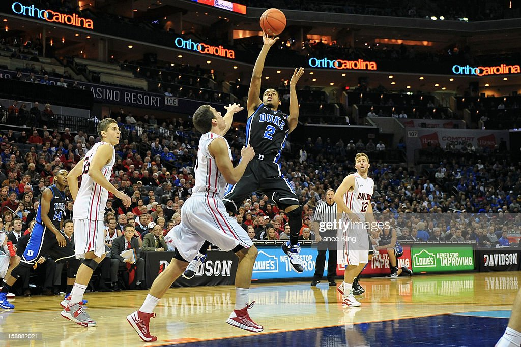 Quinn Cook #2 of the Duke Blue Devils puts up a shot against the Davidson Wildcats at Time Warner Cable Arena on January 2, 2013 in Charlotte, North Carolina.
