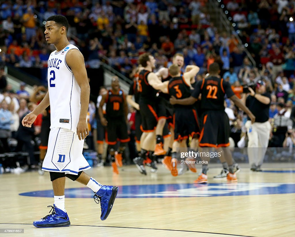 <a gi-track='captionPersonalityLinkClicked' href=/galleries/search?phrase=Quinn+Cook&family=editorial&specificpeople=6753591 ng-click='$event.stopPropagation()'>Quinn Cook</a> #2 of the Duke Blue Devils walks off the court after losing to the Mercer Bears 78-71 in the second round of the 2014 NCAA Men's Basketball Tournament at PNC Arena on March 21, 2014 in Raleigh, North Carolina.