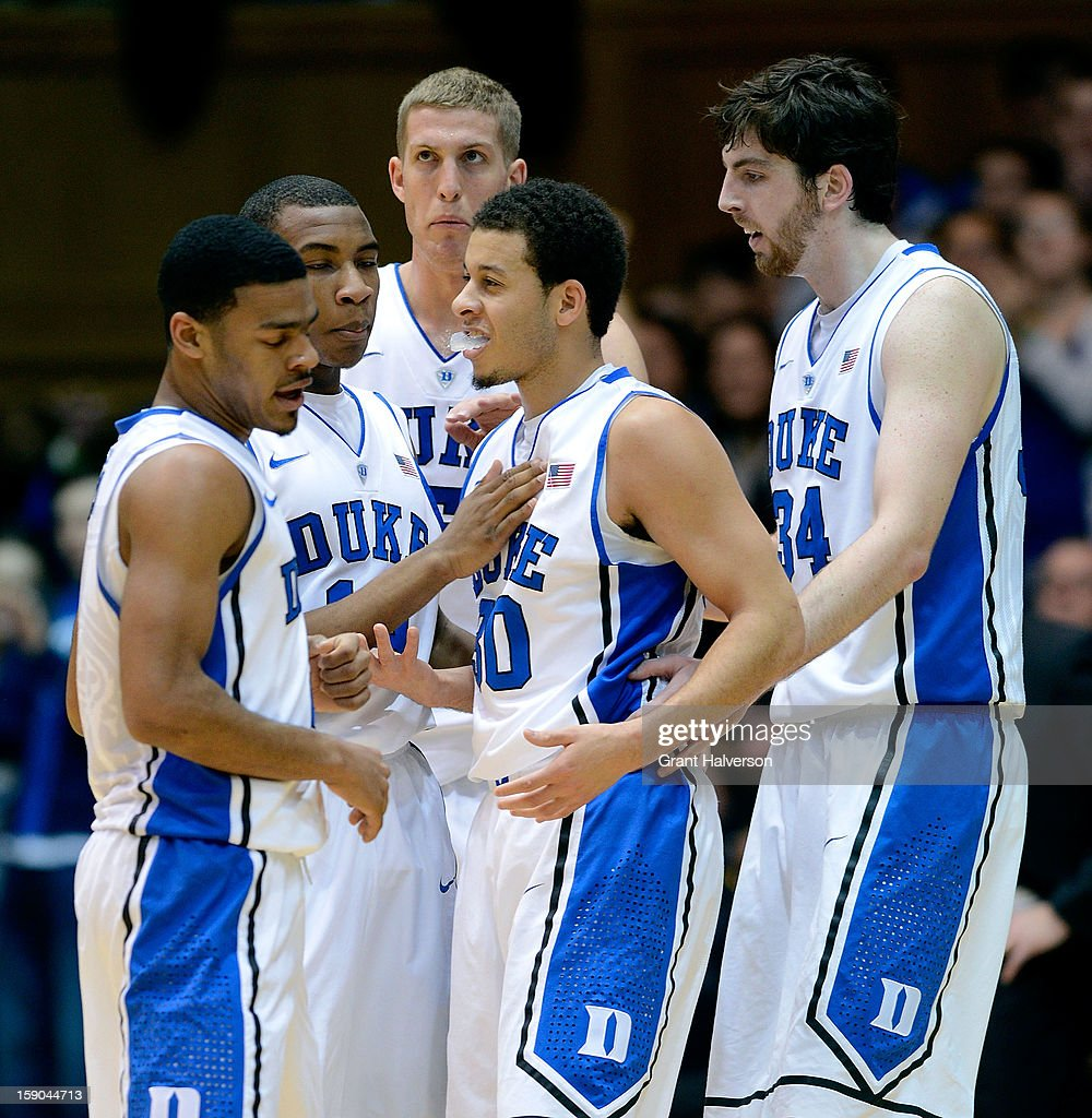 Quinn Cook #2, Rasheed Sulaimon #14, Mason Plumlee #5 and Ryan Kelly #34 congratulate teammate Seth Curry #30 of the Duke Blue Devils after Curry'sthree-point basket against the Wake Forest Demon Deacons during play at Cameron Indoor Stadium on January 5, 2013 in Durham, North Carolina. Duke won 80-62.