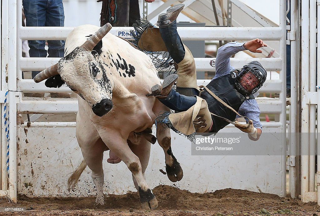 Quinn Hiser is thrown from his bull as he competes in the Bull Riding at the Prescott Frontier Days 'World's Oldest Rodeo' on July 5, 2014 in Prescott, Arizona.