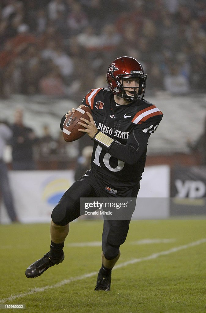 Quinn Kaehler #18 of San Diego State Aztecs rolls out of the pocket against the Fresno State Bulldogs during their game on October 26, 2013 at Qualcomm Stadium in San Diego, California.