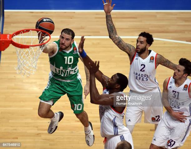 Quino Colom #10 of Unics Kazan competes with Bryant Dunston #42 of Anadolu Efes Istanbul during the 2016/2017 Turkish Airlines EuroLeague Regular...