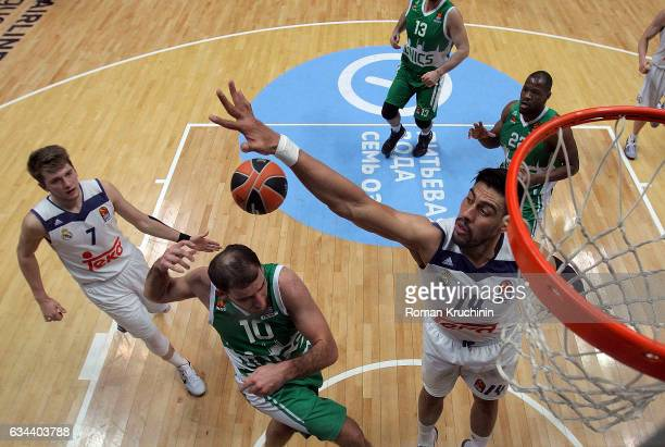 Quino Colom #10 of Unics Kazan competes with Gustavo Ayon #14 of Real Madrid during the 2016/2017 Turkish Airlines EuroLeague Regular Season Round 22...