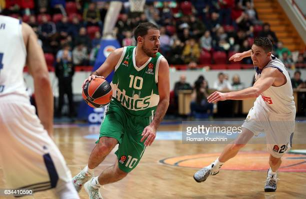 Quino Colom #10 of Unics Kazan competes with Jaycee Carroll #20 of Real Madrid during the 2016/2017 Turkish Airlines EuroLeague Regular Season Round...