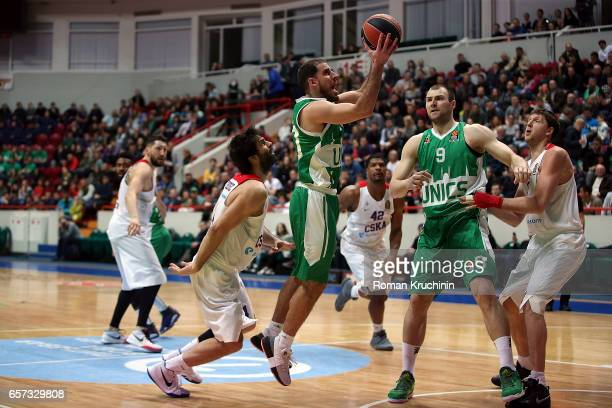 Quino Colom #10 of Unics Kazan competes with Milos Teodosic #4 of CSKA Moscow during the 2016/2017 Turkish Airlines EuroLeague Regular Season Round...